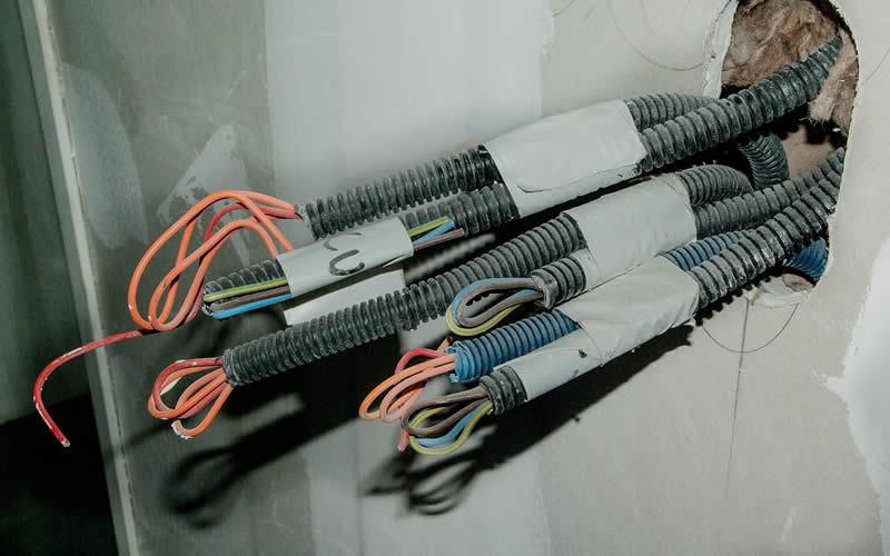 Domestic Electricians rewiring cables